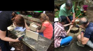 Kinder und Helfer beim Handwerken